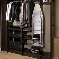 Cabinet closet with pull out ironing board