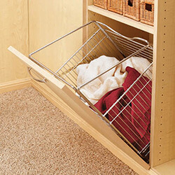 Tilt out hamper for cabinet closet